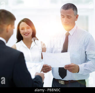 group of business people discussing an important document. - Stock Photo