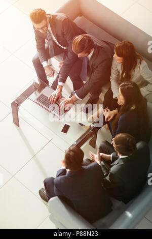 Business team high fiving in the office. - Stock Photo