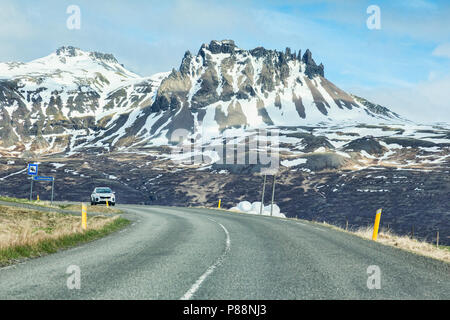 28 April 2018: South Iceland - Through the windscreen shot of the Iceland Ring Road in South Island, driving through snowy mountain scenery. Probably  - Stock Photo