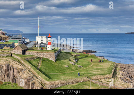 26 April 2018: Torshavn Faroe Islands - Historic Skansin Fortress and Lighthouse. - Stock Photo