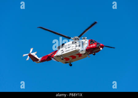 HM Coastguard Sikorsky S-92A helicopter, registration number G-MCGH.  Near Glossop in the Peak District, Derbyshire, England, UK. - Stock Photo