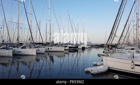 Sailboat harbor with many beautiful moored sail yachts in the sea port. Olbia, Sardinia, Italy - Stock Photo
