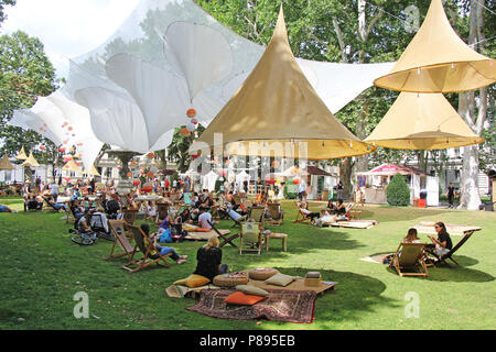 ZAGREB, CROATIA - JULY 7TH, 2018 :Open Festival in the City Park Zrinjevac when many people are socializing with reading books and drinks in Zrinjevac - Stock Photo