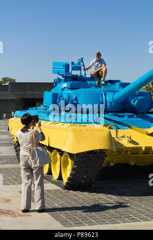 KIEV, UKRAINE - AUGUST 9, 2015: Russian T55 tank captured in Eastern Ukraine by the Ukrainian army painted with the Ukrainian colors used as a trophy  - Stock Photo