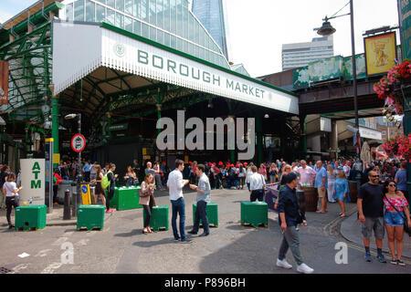 Shoppers at Borough Market London - Stock Photo