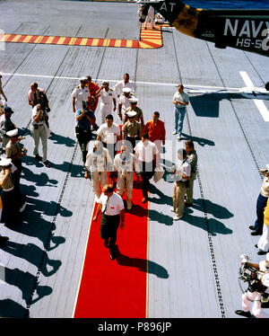 Astronauts L. Gordon Cooper Jr. (right center), Gemini-Titan 5 and Charles Conrad Jr., pilot, receive a red-carpet welcome as they arrive aboard the aircraft carrier USS Lake Champlian - Stock Photo