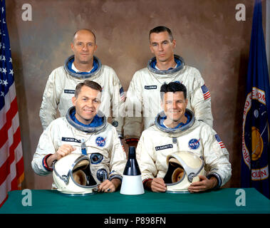 Back row - astronauts Thomas P. Stafford (left), command pilot, and Eugene A. Cernan, pilot. Front row - backup astronauts Elliott M. See Jr., command pilot, and Charles A. Bassett II - Stock Photo
