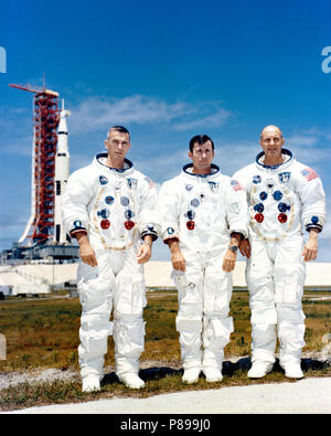 Prime crew of Apollo 10 sits for photo while at Kennedy Space Center for preflight training. L to R are astronauts Eugene A. Cernan, John W. Young, and Thomas P. Stafford, commander - Stock Photo