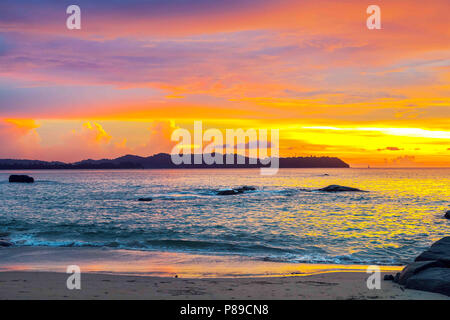 Colorful sunset over the sea in Thailand. - Stock Photo
