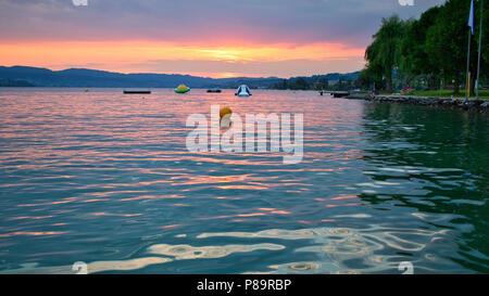lake of Zurich sunset and bathing - Stock Photo