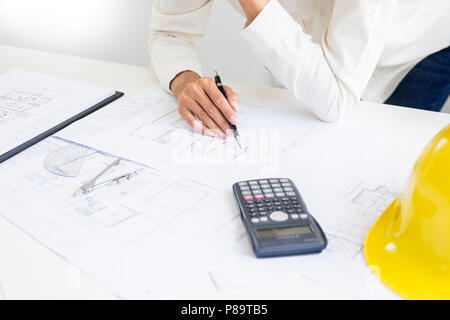 Close-up Of Person's engineer Hand Drawing Plan On Blue Print with architect equipment, Architects discussing at the table, team work and work flow co - Stock Photo