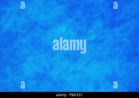 A grainy mottled blue background texture, with clouded effect. Suitable for backgrounds or overlays. - Stock Photo