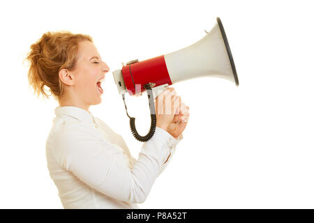 Young woman yells loudly in a megaphone for motivation - Stock Photo