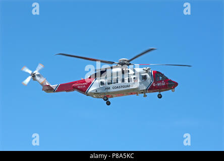 HM Coastguard S-92 rescue Helicopter returning to it's base at Inverness Airport in the Scottish Highlands. - Stock Photo