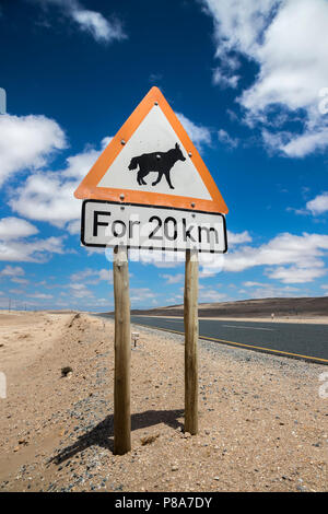 Road sign warning of brown hyaena, Namibia - Stock Photo