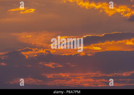 The beauty of the evening sky with dense clouds and the sun trying to break through them. . For your design - Stock Photo