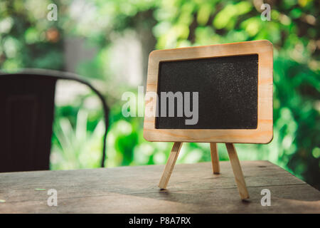 Small blackboard with large space for your copy text - Stock Photo