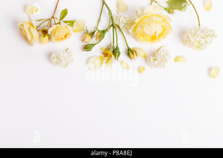 Festive flower English rose composition on the white wooden background. Overhead top view, flat lay. Copy space. Birthday, Mother's, Valentines, Women - Stock Photo