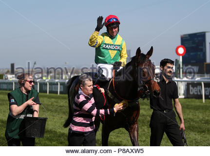 File photo dated 08-04-2017 of Robbie Power on board Finian's Oscar celebrates winning the Betway Mersey Novices' Hurdle on Grand National Day of the Randox Health Grand National Festival at Aintree Racecourse. - Stock Photo