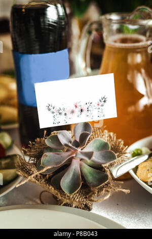 unusual cactus plant on a wedding festive table - Stock Photo