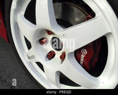 Mitsubishi Lancer Evolution 7 vii EVO - 2002 model in red colour - showing rally car style wheels and brakes modified - Stock Photo