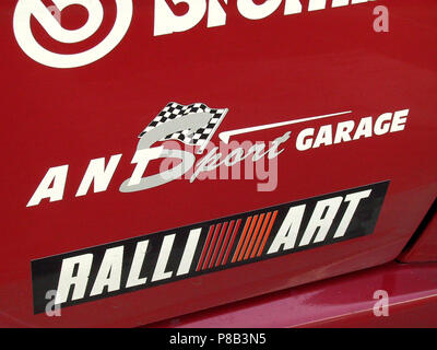 Mitsubishi Lancer Evolution 7 vii EVO - 2002 model in red colour - showing rally car style decals from sponsors - Stock Photo