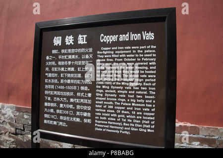Copper and Iron Vats wall plaque at the Imperial Palace in the Forbidden City, in China, offerring tourist information about chinese culture. - Stock Photo