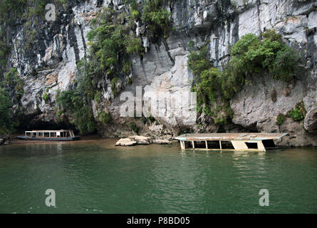 An old sunken boat on the Li River in Guangxi Zhuang china, on the journey from Guilin to Yangshuo. - Stock Photo