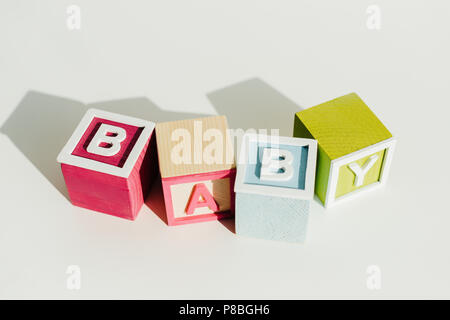 Word baby on letter wooden blocks - Stock Photo