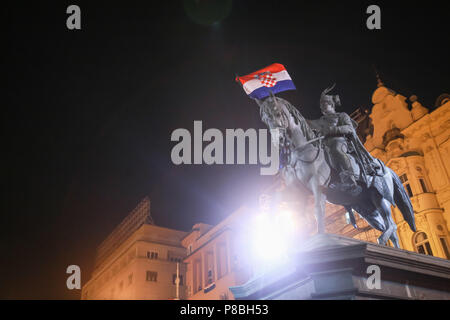 ZAGREB, CROATIA - JULY 7TH, 2018 : Croatian football fans flagged the Croatian flag on the statue of Ban Josip Jelacic after win of Croatian national  - Stock Photo
