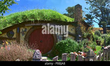 panoramic view of Sam`s Hobbit hole at the Hobbiton movie set, Matamata Nz - Stock Photo