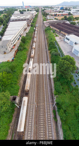 Aerial view freight trains in railway station. Cargo trains wagons on railroad, top down. Heavy industry conceptual, rail track in industrial district - Stock Photo