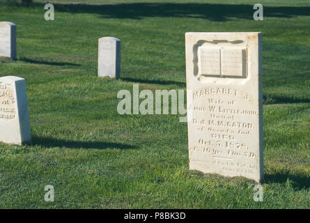 Grave of army laundress Margaret Littlejohn, Custer National Cemetery, Montana. Photograph - Stock Photo