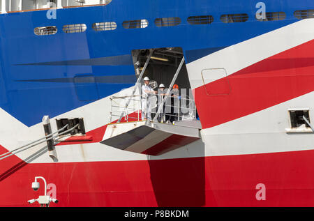Ship's officer standing on the mooring plaform to oversee the safety of the berthing of this cruise liner, Port of Southampton, England UK - Stock Photo