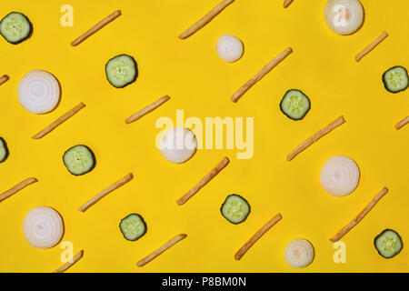 Heap of french fries on yellow background, top view - Stock Photo