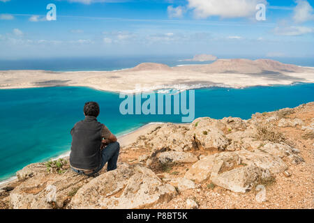 View over La Graciosa island and Chinijo Archipelago from the north coast of Lanzarote, Canary Islands, Spain - Stock Photo