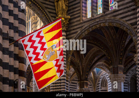Dome of the Cathedral of Siena with a banner of Valdimontone, Cattedrale di Santa Maria Assunta, interior view, Siena, Tuscany, Italy - Stock Photo