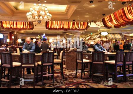 LAS VEGAS, USA - APRIL 14, 2014: People visit Bellagio resort in Las Vegas. The famous casino resort has almost 4,000 rooms. - Stock Photo