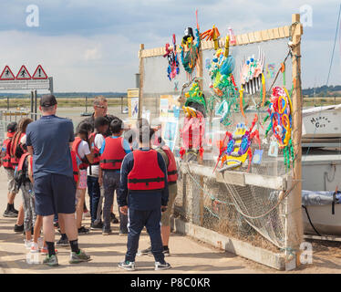Group of school children on a day trip to Mersea Island, about to go crabbing. - Stock Photo