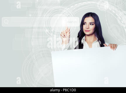 Young woman holding white empty board and pointing to empty address bar in virtual web browser. Seo, internet marketing and advertising marketing conc - Stock Photo