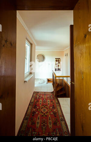 A small corridor in the room with a track on the floor leading to the steps along which you can go down to the floor below. . For your design - Stock Photo