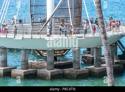 PUERTO VALLARTA, MEXICO - MARCH 11, 2018: , A scenic pier with a unique, sleek, contemporary design and lively activity on Playa Los Muertos Pier, MX- - Stock Photo