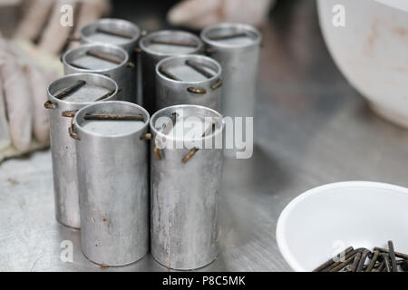 industrial equipment in fermented pork sausage production process - Stock Photo