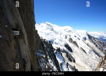Even during summer ice and snow is omnipresent on the Mont Blanc. Seen from the observation platform on top of the Aiguille-du-Midi in France - Stock Photo