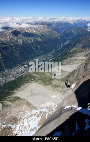 Cable car from Chamonix, France, arriving the top station on the Aiguille-du-Midi in the Mont Blanc massif - Stock Photo