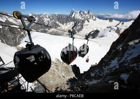 The cable car reaches the top station at the Aiguille-du-Midi in the Mont Blanc massif, France - Stock Photo