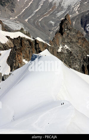 Mountain climbers on their way up to the peak of the Mont Blanc in France - Stock Photo