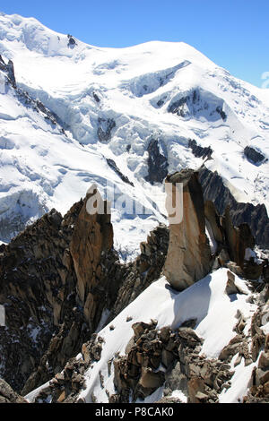 Even during summer ice and snow is omnipresent on the Mont Blanc. Seen from the Aiguille-du-Midi in France - Stock Photo