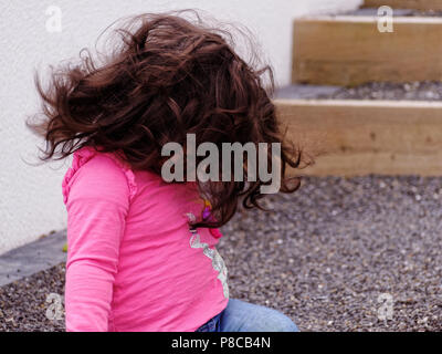 Baby girl white 20 months old big Natural Brown hair,  Robert Taylor/Alamy Live News.  Newquay, Cornwall, UK. - Stock Photo