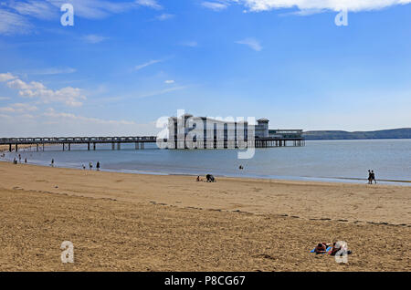 Weston-super-Mare, UK. 10th July, 2018. UK weather: as the heatwave continues and the temperature reaches 75º F, those who can get away from work on a weekday afternoon take to the beach to sunbath and swim. Keith Ramsey/Alamy Live News - Stock Photo